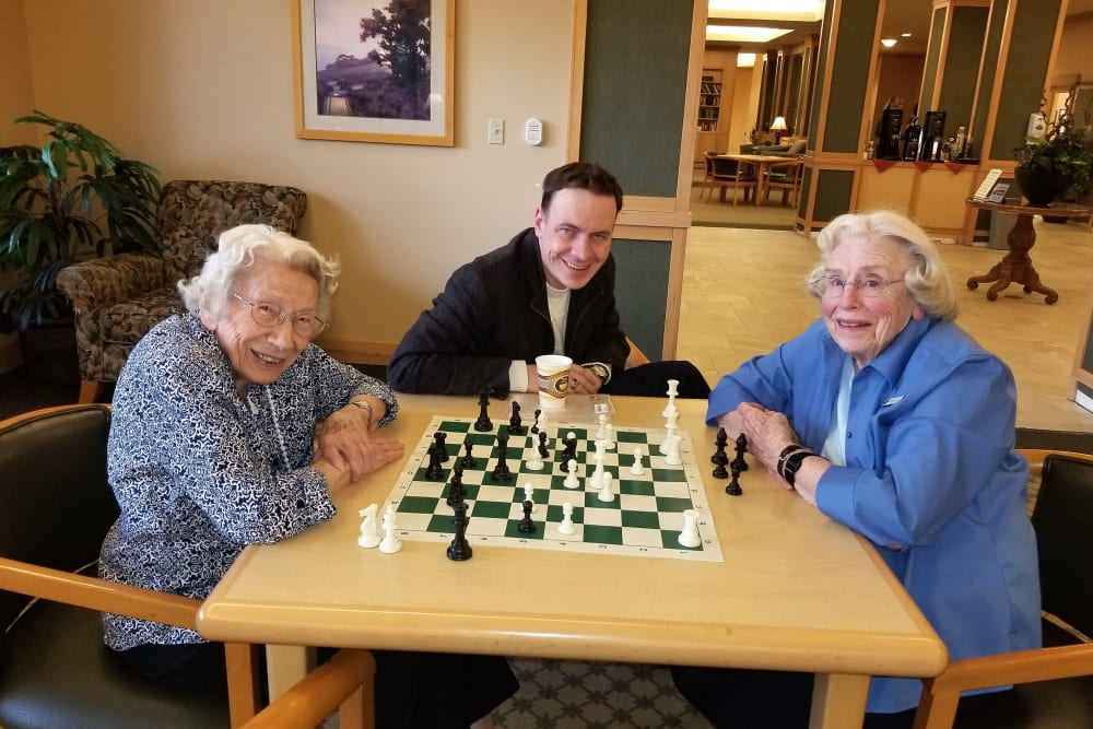 Residents playing chess at Merrill Gardens at Renton Centre in Renton, Washington.