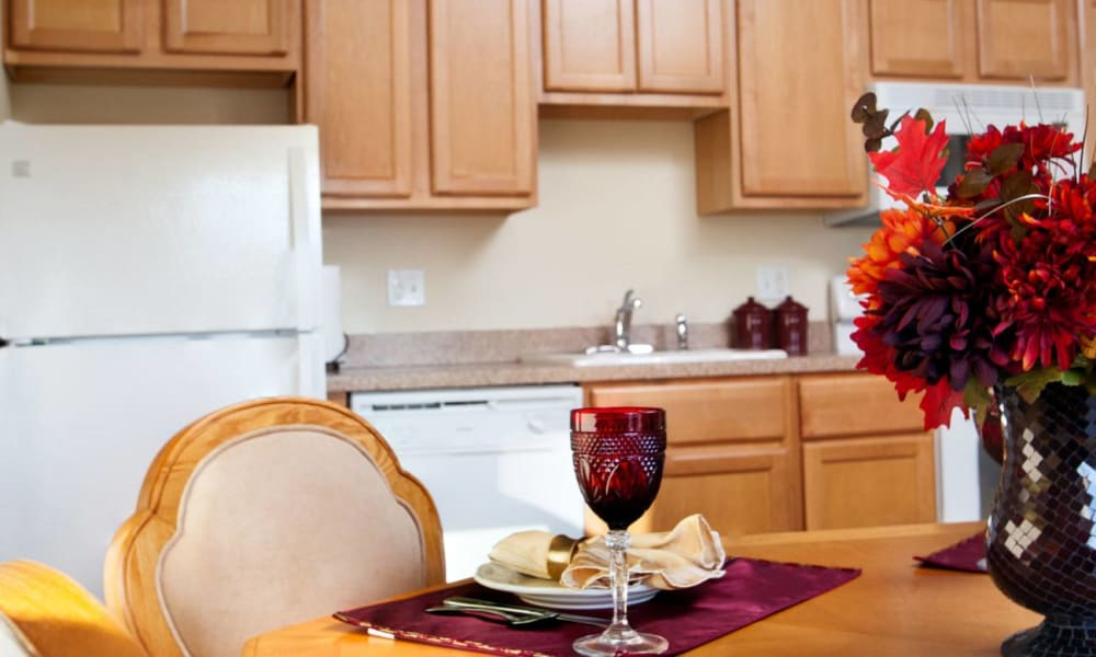 Dining room and kitchen in an independent living apartment at Governor's Port in Mentor, Ohio