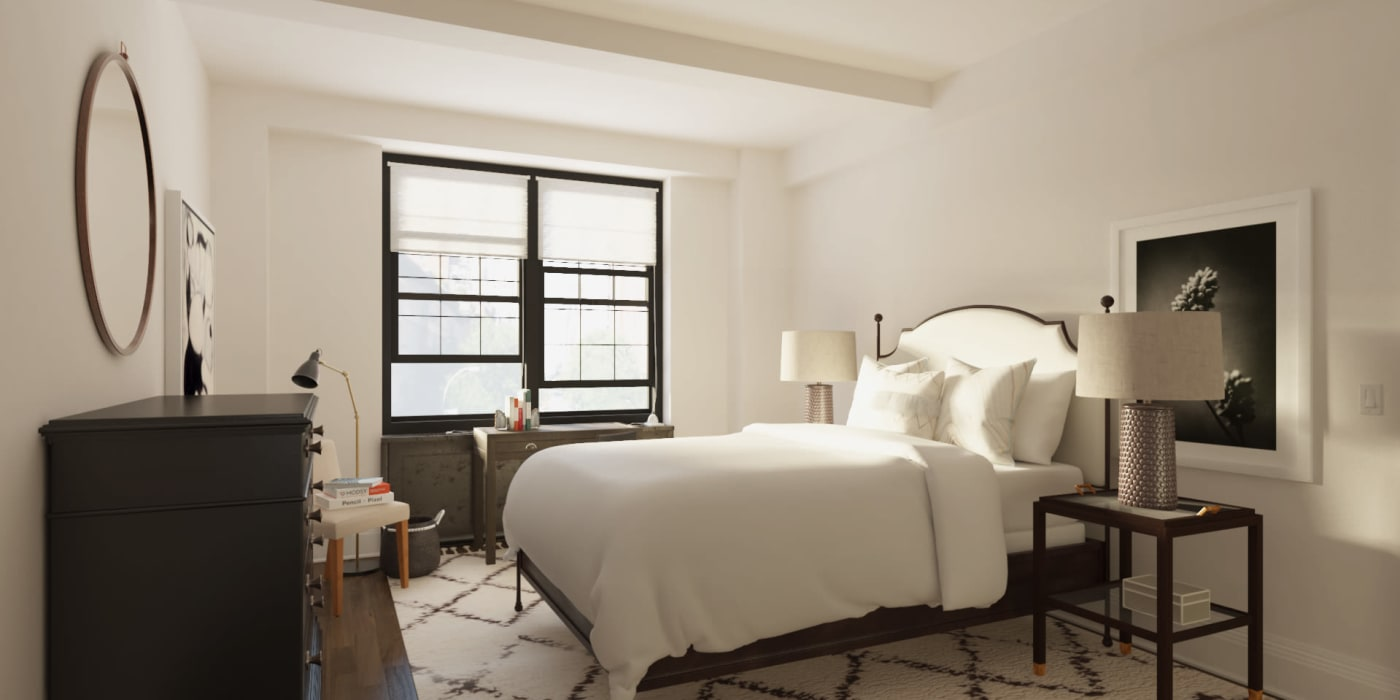 Main bedroom with two large windows at London Terrace Gardens in New York, New York