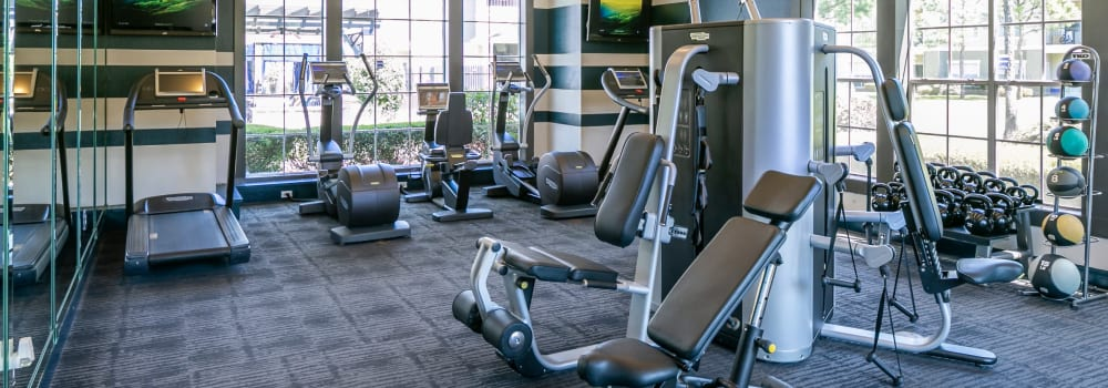 A fitness center with plenty of individual workout stations at The Fuse at Park Row in Houston, Texas