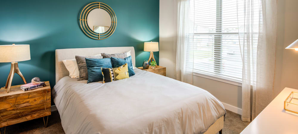 Nice well lit bedroom in a decorate model home at Flats At 540 in Apex, North Carolina