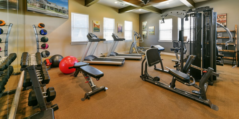 Well equipped spacious fitness center at Cottages at Abbey Glen Apartments in Lubbock, Texas