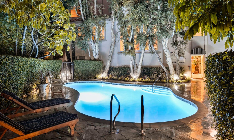Underwater lights illuminating the pool in the evening at L'Estancia in Studio City, California