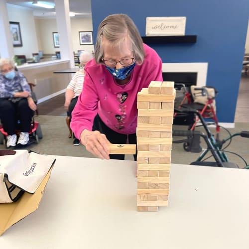 Residents playing Jenga at Madison House in Norfolk, Nebraska