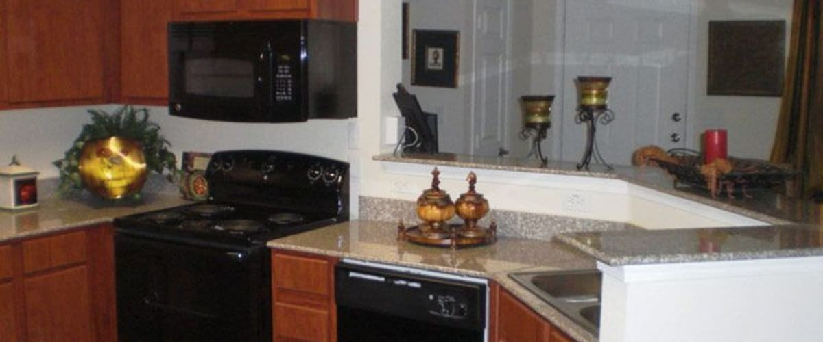 A kitchen with a microwave at Woodside Manor in Conroe, Texas