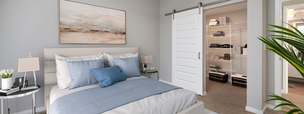 A comfortable master bedroom with oversized closet at Hawthorne Hill Apartments in Thornton, Colorado