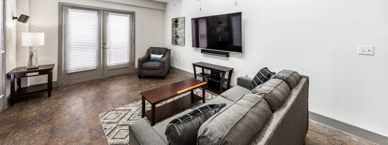 Bright living room at Regents West at 26th in Austin, Texas