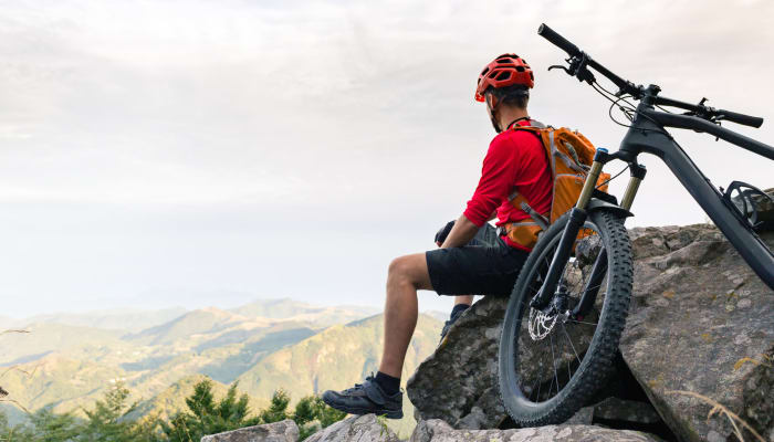 A man enjoying the view while mountain biking near STOR-N-LOCK Self Storage in Hurricane, Utah