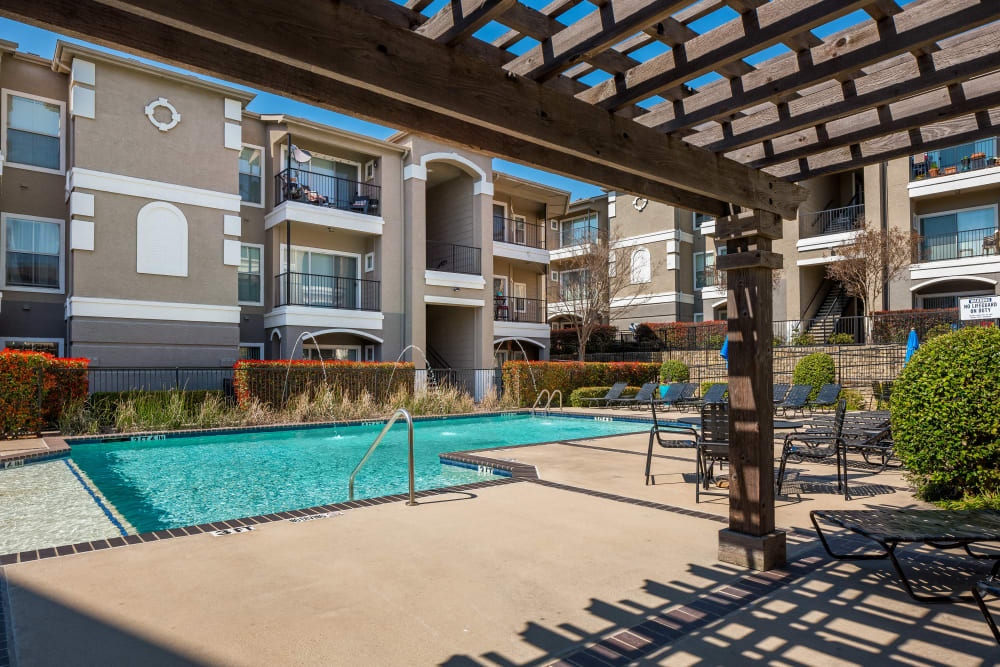 Pergola providing partial shade near the pool at Vail Quarters in Dallas, Texas