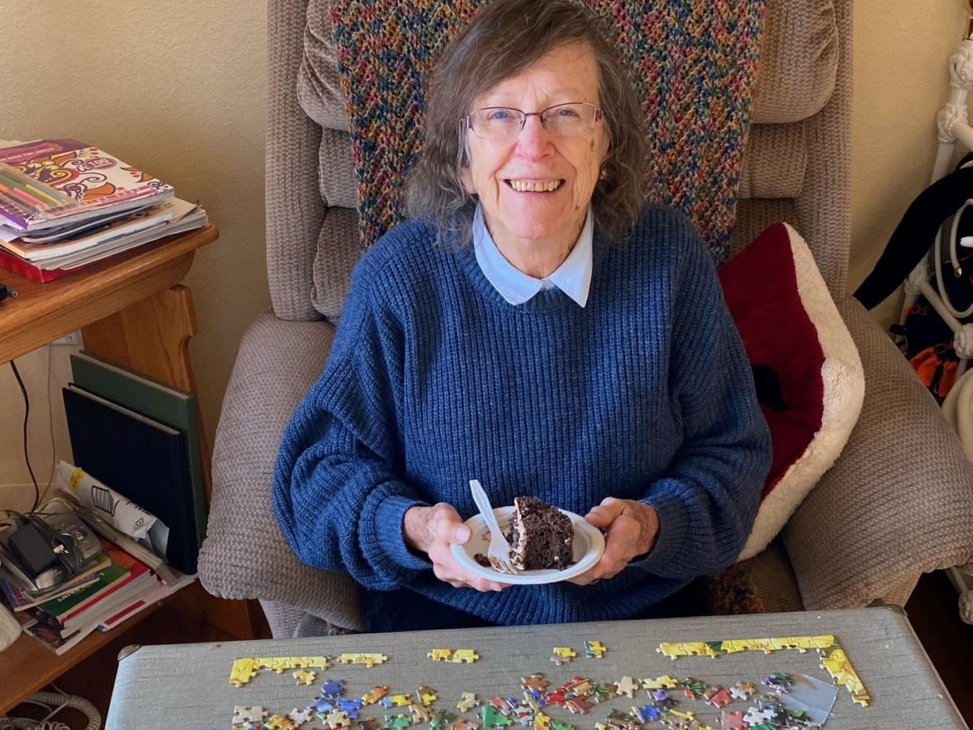 Doing a large jigsaw puzzle at Seven Lakes Memory Care in Loveland, Colorado