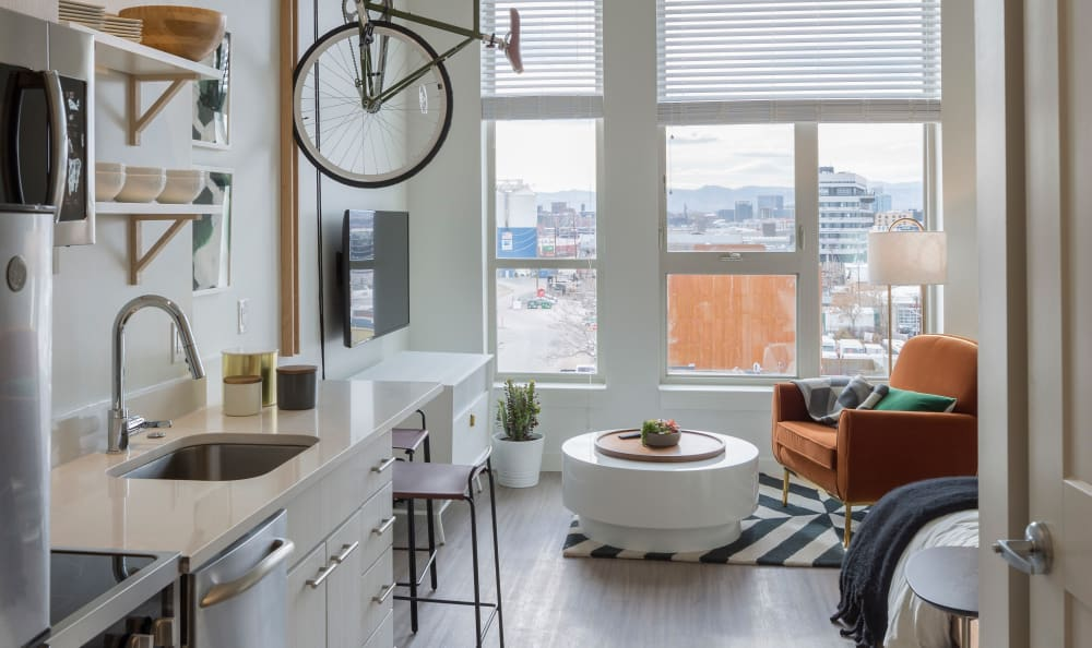 Kitchen with white cabinets at RiDE at RiNo in Denver, Colorado
