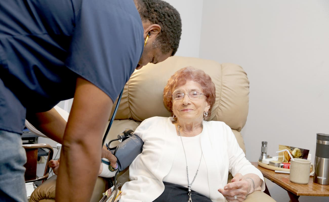 A resident getting medical care at Providence Assisted Living in Senatobia, Mississippi.