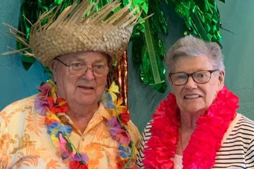 Residents enjoying a Hawaiian party at Villas of Holly Brook Chatham in Chatham, Illinois