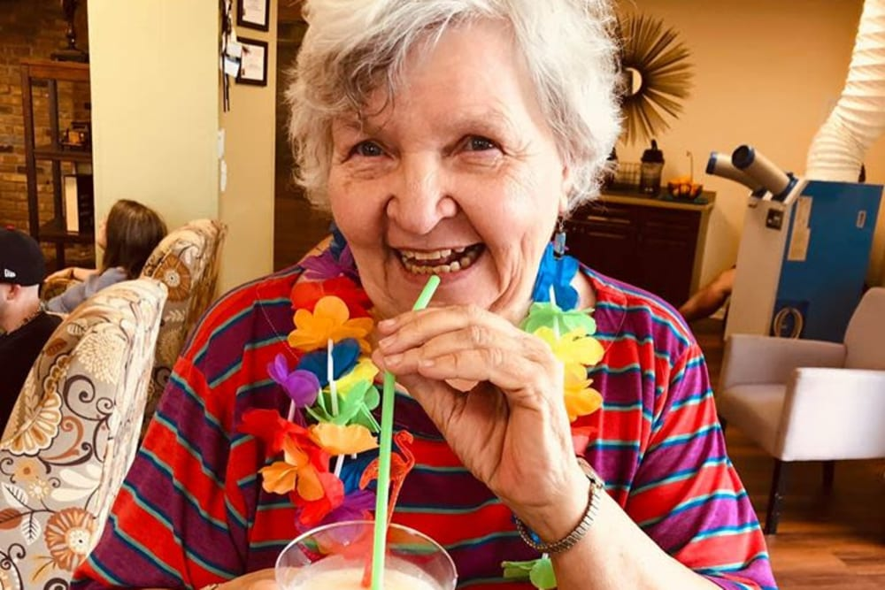 A resident enjoying a drink at Bayside Terrace in Pinellas Park, Florida