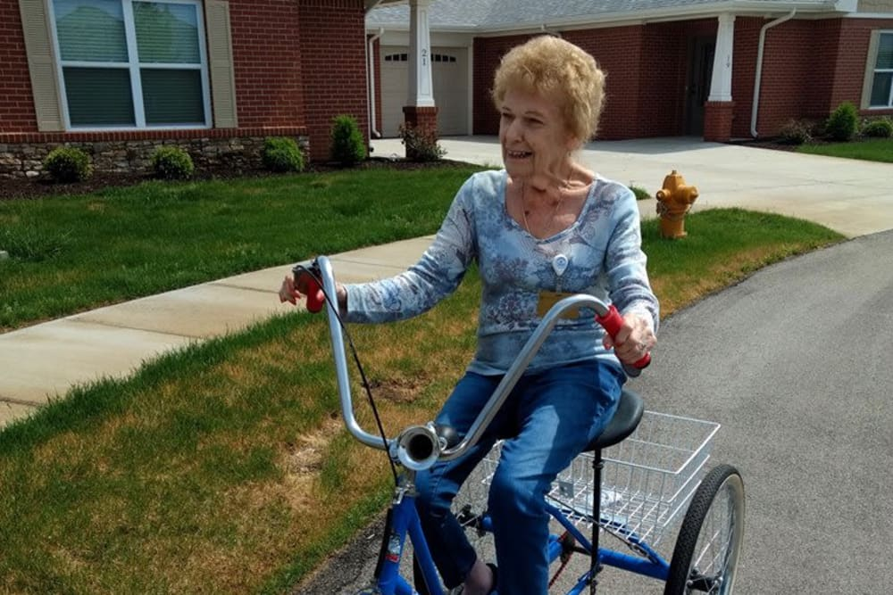A resident riding her tricycle through Creasy Springs Health Campus in Lafayette, Indiana