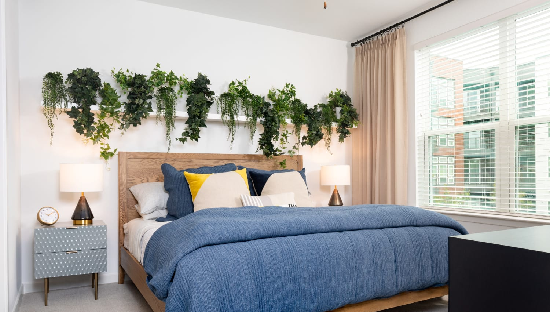 Model bedroom at Olympus on Broadway in Carrollton, TX