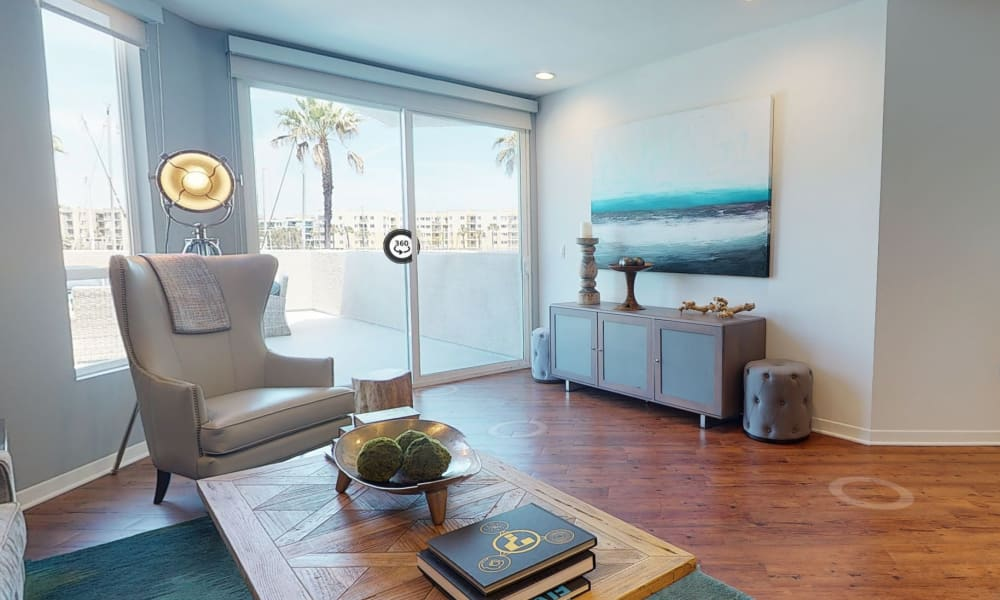 Hardwood flooring and marina views from the living area of a model home at Esprit Marina del Rey in Marina Del Rey, California