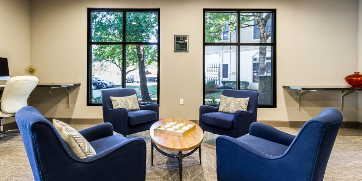 Community lounge seating area with big windows at Marquis at Barton Trails in Austin, Texas