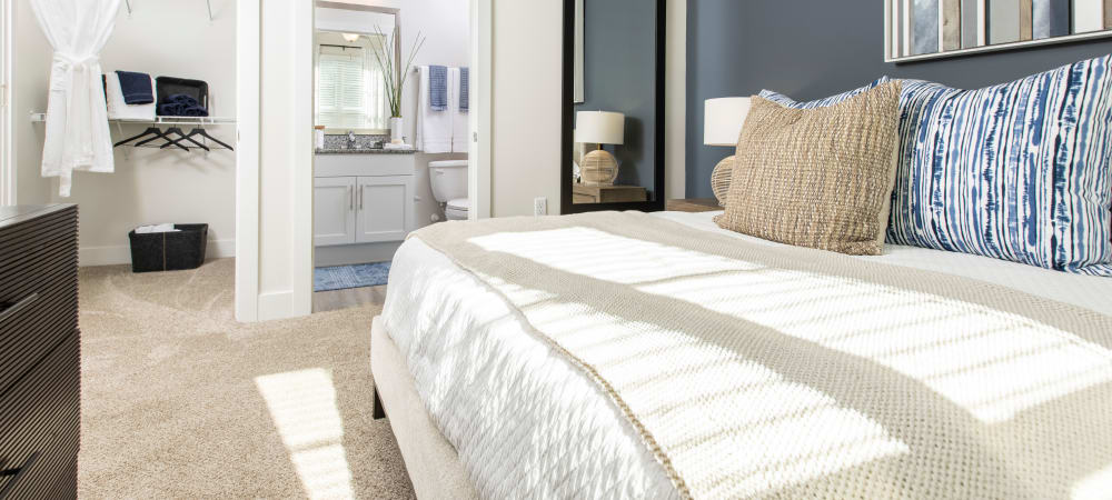Nice well lit bedroom in a decorate model home at South City Apartments in Summerville, South Carolina