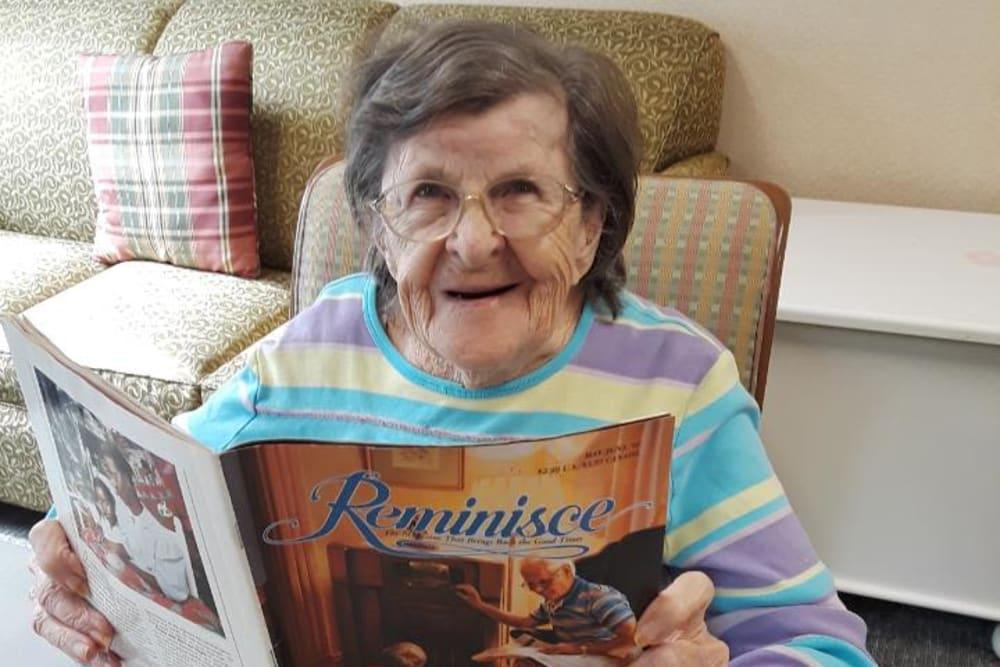 Resident reading in her living room at Willow Creek Senior Living in Elizabethtown, Kentucky.