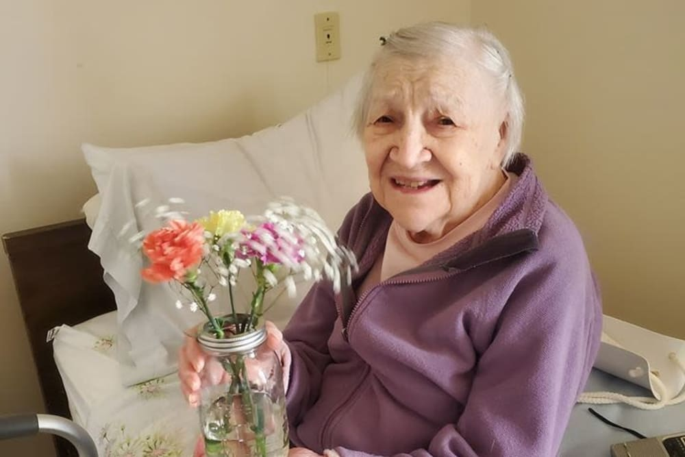 Resident with flowers at Victory Centre of Joliet