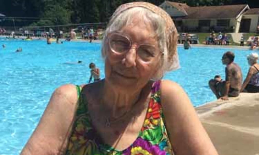 resident in a swim suit by the pool at Heritage Hill Senior Community in Weatherly, Pennsylvania