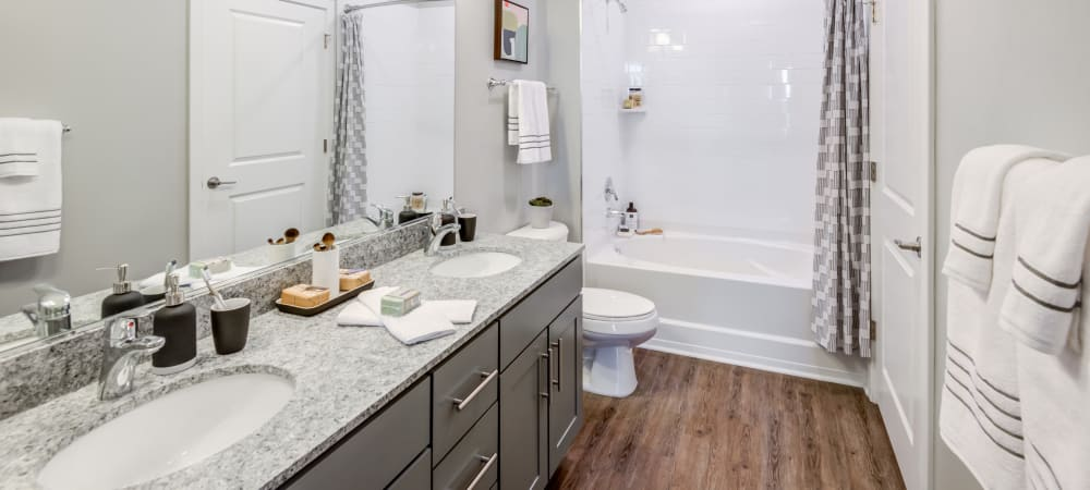 Spacious bathroom with large mirror and ample counter space at Flats At 540 in Apex, North Carolina