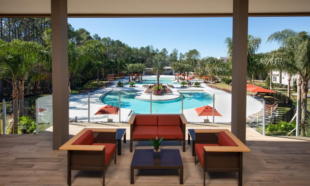 Shaded lounge area overlooking the swimming pool at Luxor Club in Jacksonville, Florida