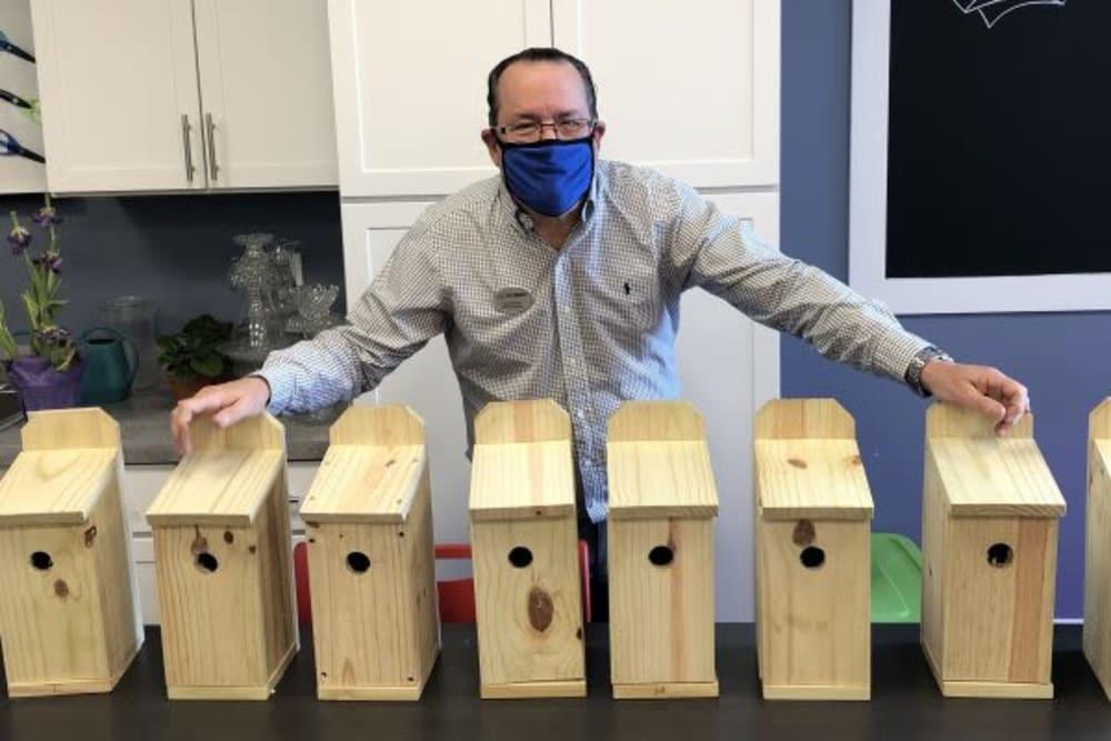 A resident showing handmade birdhouses at Mercer Hill at Doylestown in Doylestown, Pennsylvania