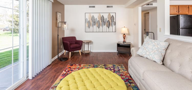 Spacious living room at Maplewood Estates Apartments in Hamburg, New York