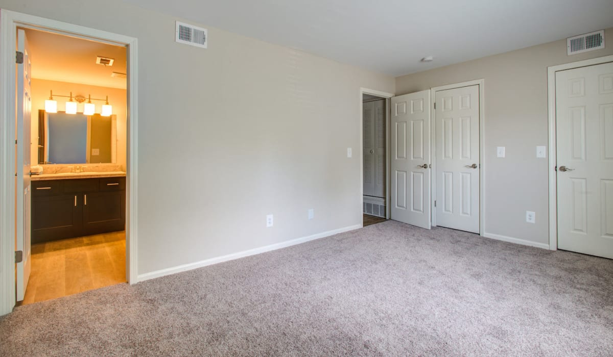 Spacious main bedroom with carpeting at Kensington at Beverly Hills in Southfield, Michigan