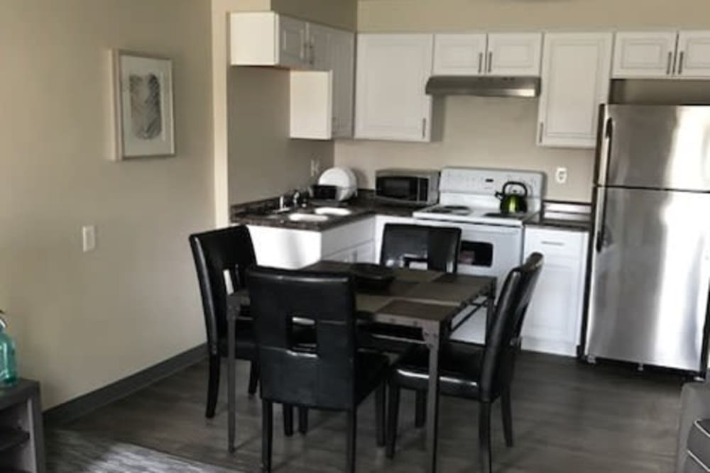 Kitchen and dining table at Capitol Hill Apartments in Denver, Colorado