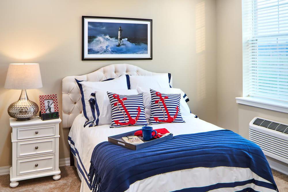 A cozy bedroom at Anthology of Overland Park in Overland Park, Kansas