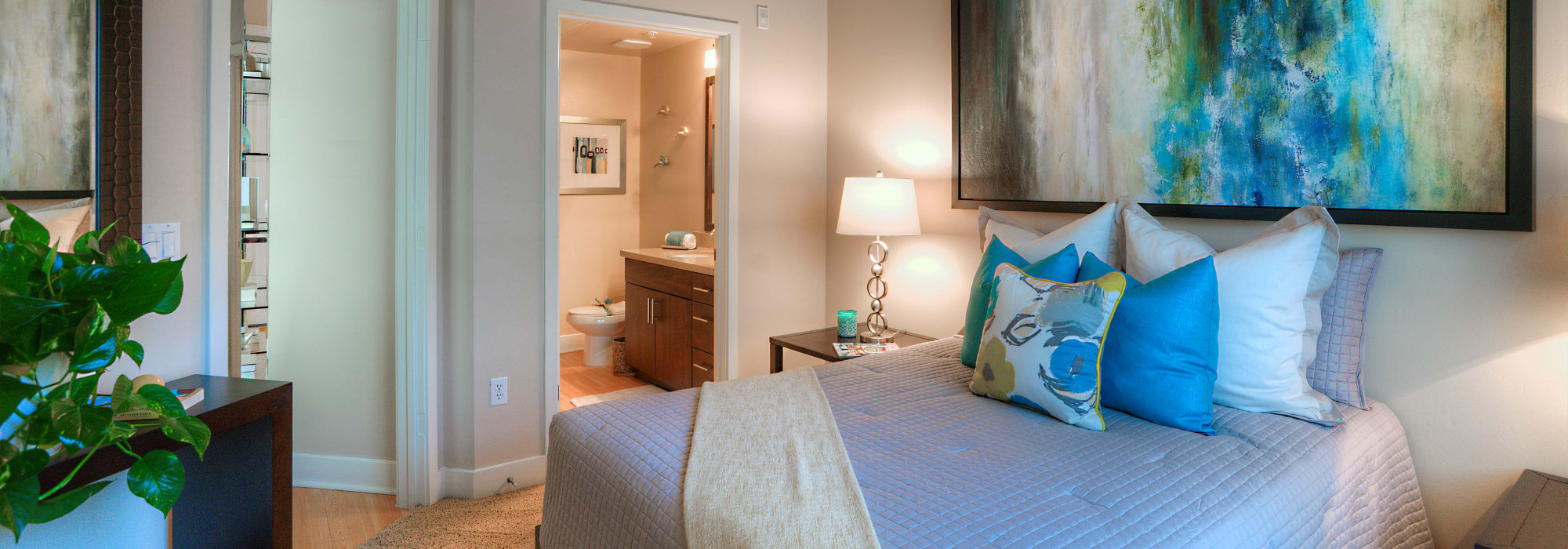 Master bedroom with en suite bathroom in model home at Level at Sixteenth in Phoenix, Arizona