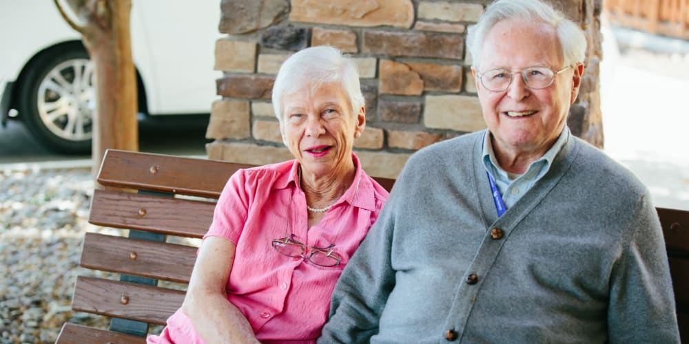 Resident couple sitting outside enjoying the nice day at The Springs at Missoula in Missoula, Montana