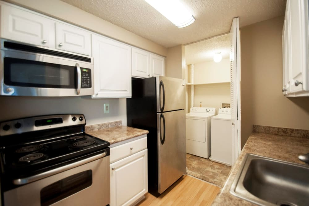 Kingscrest Apartments kitchen model with stainless steel appliances  in Frederick, Maryland