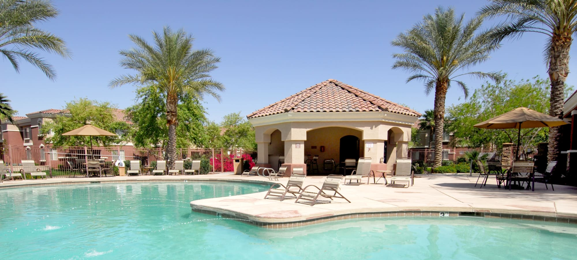 Resort-style swimming pool with lounge chairs at Remington Ranch in Litchfield Park, Arizona