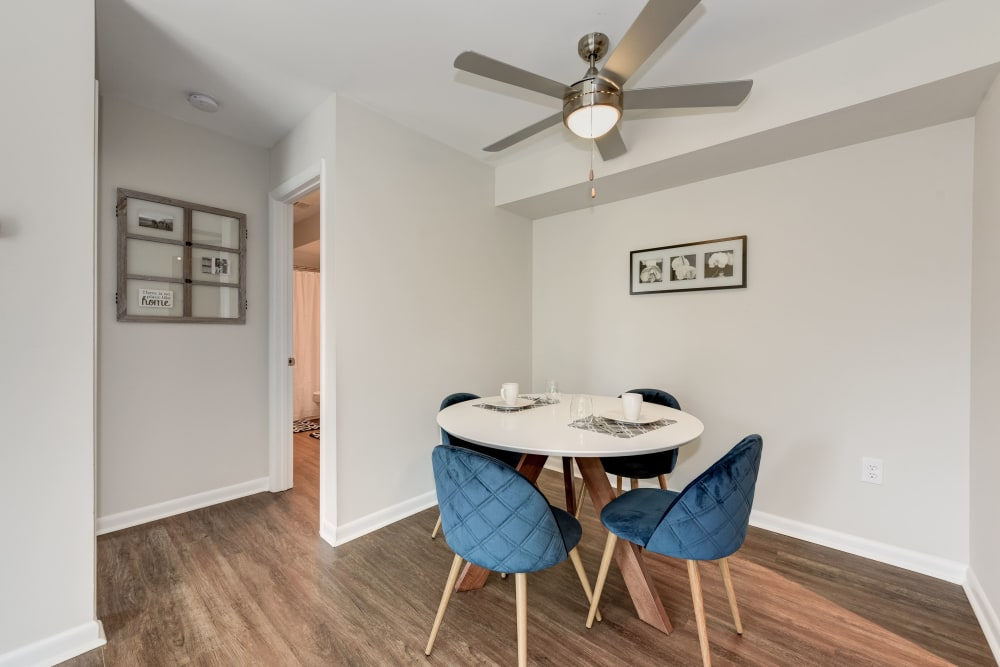 A dining room with a ceiling fan at The Landings I & II Apartments in Alexandria, Virginia
