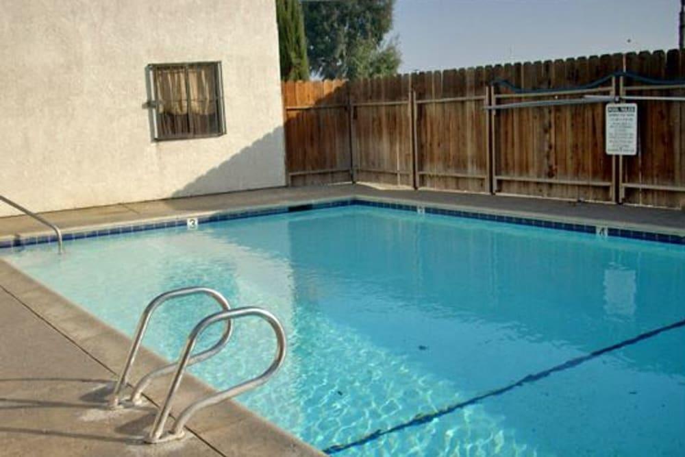 The spacious swimming pool at El Potrero Apartments in Bakersfield, California