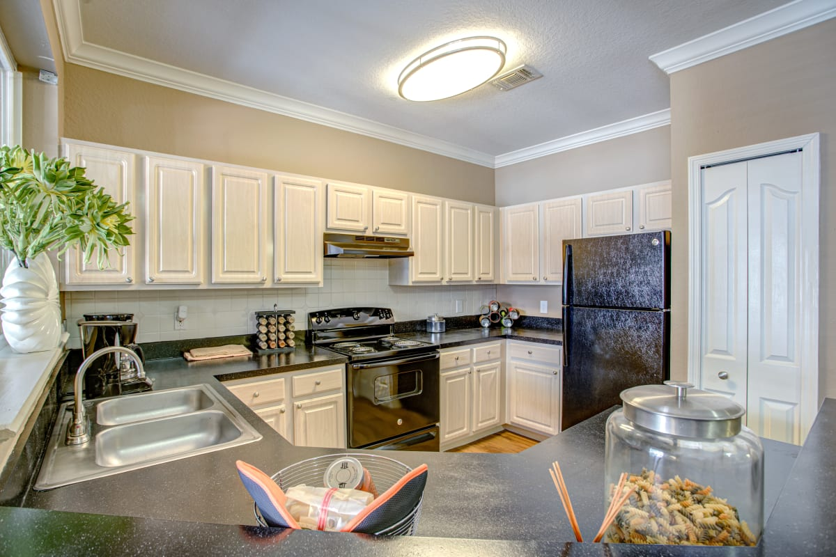 Spacious open kitchen with plenty of counter top space at Amara at MetroWest in Orlando, Florida