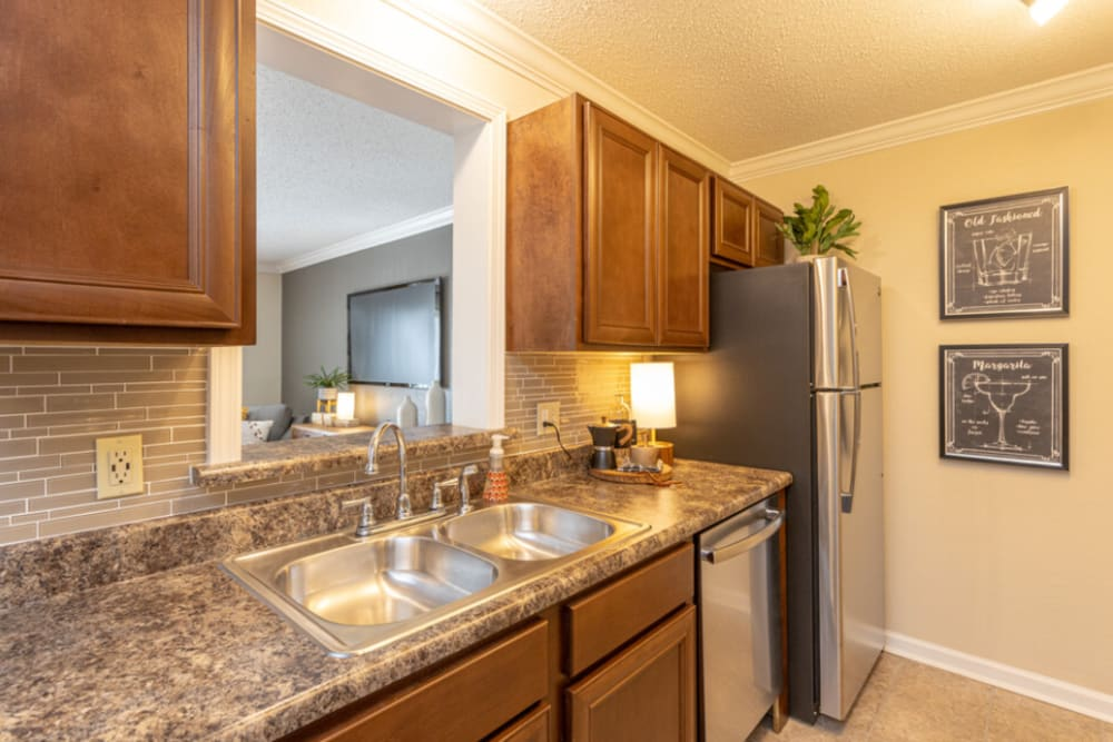 Fully-equipped kitchen at The Abbey at Riverchase apartments