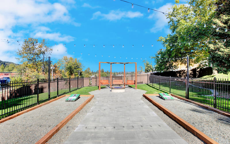 Corn hole courts and fire pit at Park South Apartments in Seattle, Washington