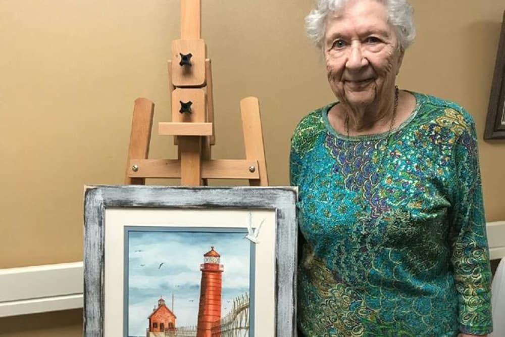 A resident with her painting at Cumberland Pointe Health Campus in West Lafayette, Indiana