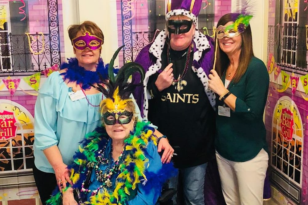 Resident and staff having Mardi Gras fun at River Pointe Health Campus in Evansville, Indiana