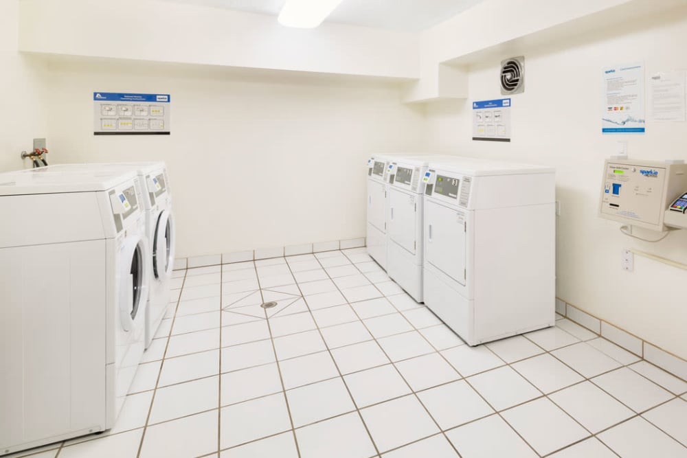 On-site laundry facility at Lakeview Mews in Calgary, AB