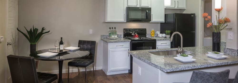 A kitchen with an open layout at Sommerall Station Apartments in Houston, Texas