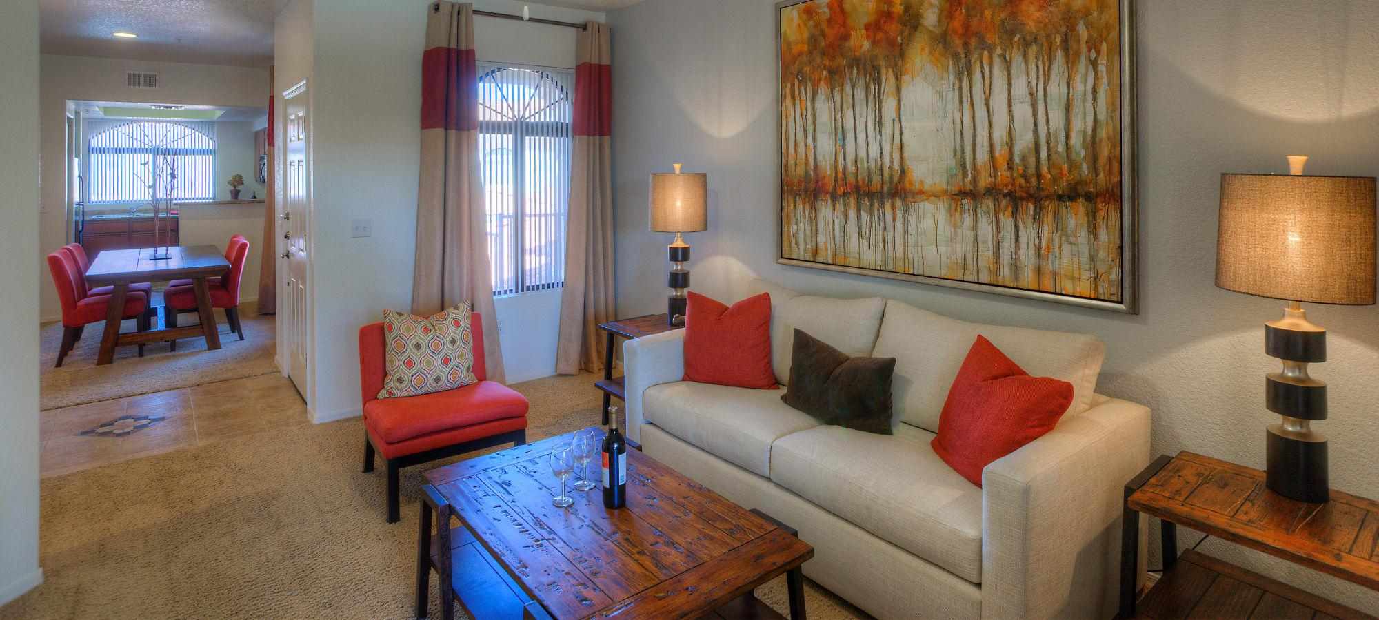 Lovely model living room and dining room at San Prado in Glendale, Arizona