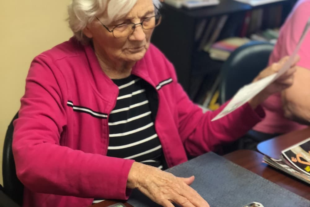 Female resident working on a collage at Springview Manor in Lima, Ohio
