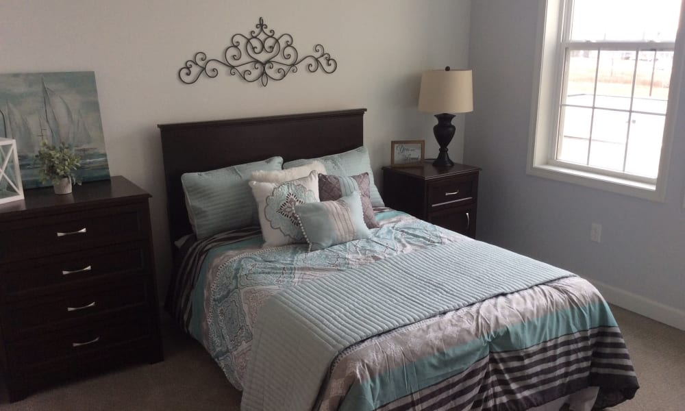 Senior living apartment bedroom at Serenity in East Peoria, Illinois