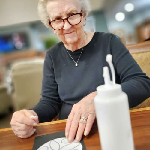 A resident doing an art project at Glen Carr House Memory Care in Derby, Kansas